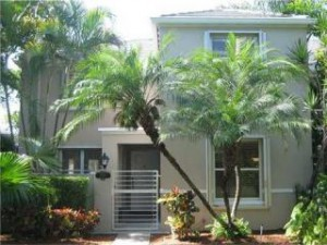 Bridgepoint Townhomes in South Miami with 24-hour security, lovely lake, and amenities.