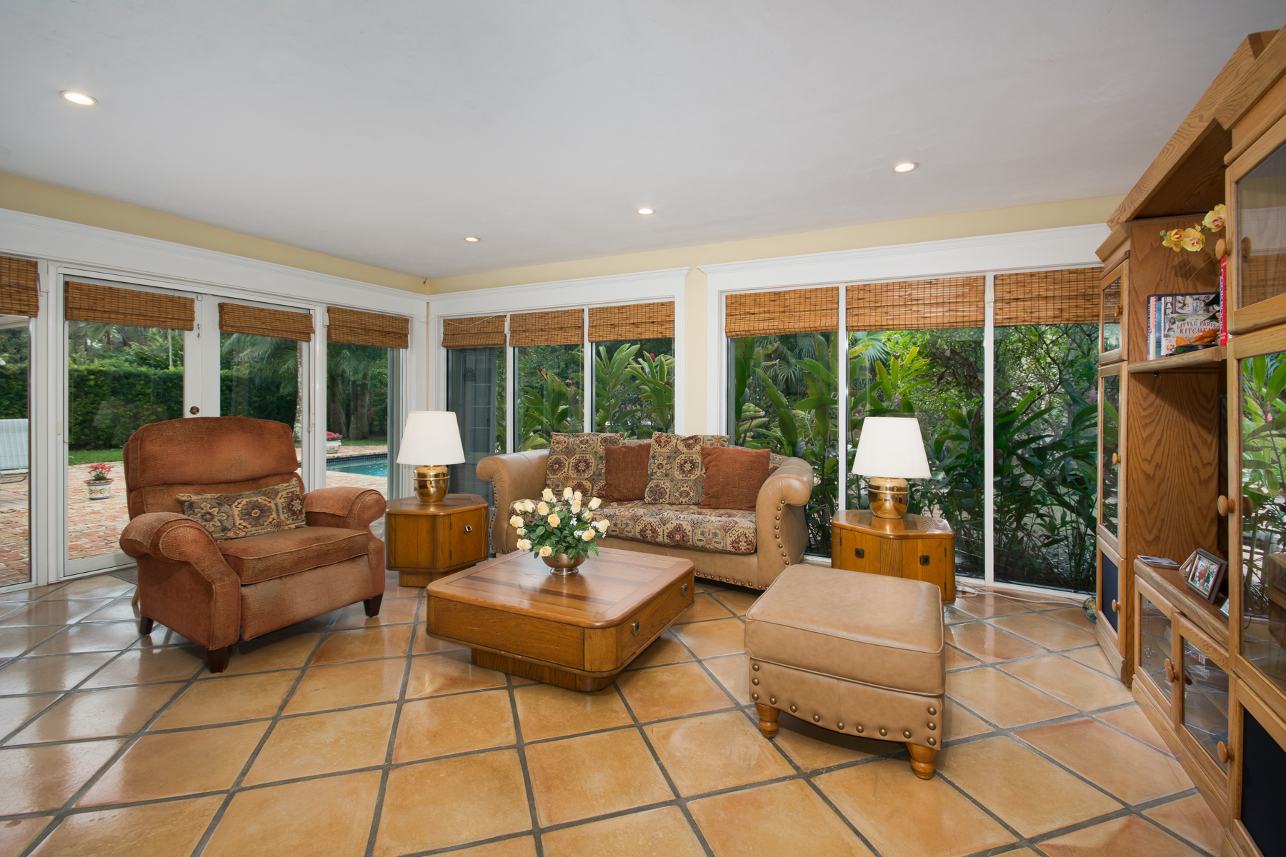 05 Family Room with Pool and Garden Views | Miami Real Estate Works
